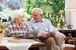 Leinwandbild Motiv Senior couple, reading