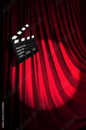 Photo  Movie clapper board against curtain