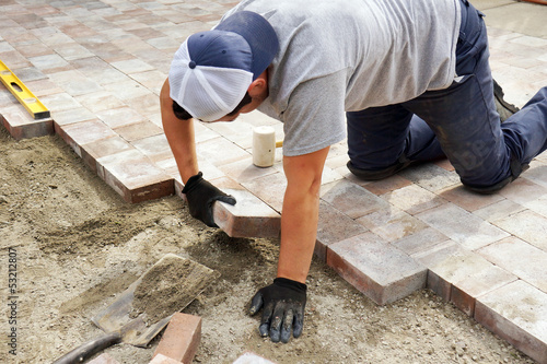 Fotografie, Obraz Laying down paver