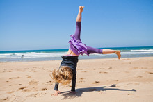 Young Girl Doing Cartwheel At ...