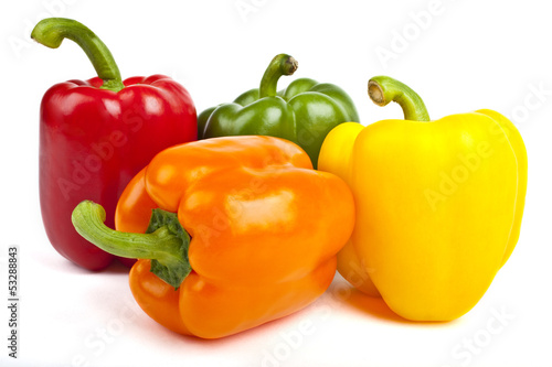 Fotografia Bell Peppers over a white background.