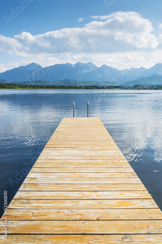 Jetty with lake and alps