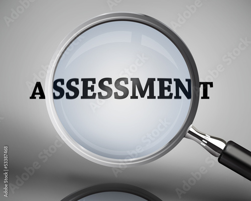 Magnifying glass showing assessment word Wallpaper Mural