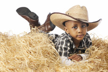 Young Cowboy Relaxing In The Straw