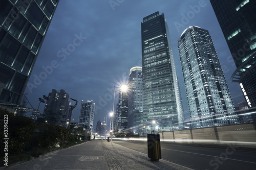 Photo  The highway car light trails of modern urban buildings
