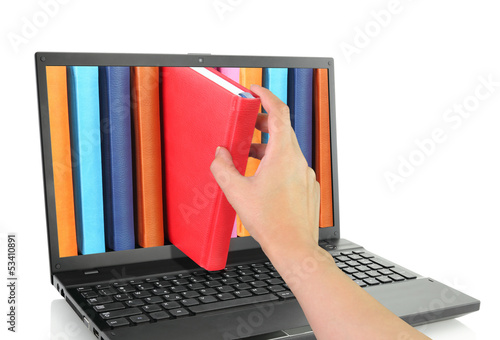 Laptop computer with colored books.