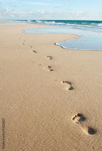 Human footprints on the beach sand Poster Mural XXL