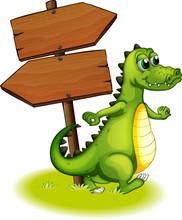 A Crocodile Beside The Wooden Empty Arrowboard