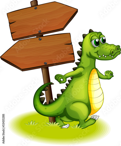 Photographie A crocodile beside the wooden empty arrowboard