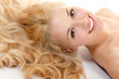 Leinwanddruck Bild - beautiful long blond healt curly hair of young attractive woman