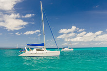 Catamarans Anchored In Calm Turquoise Water