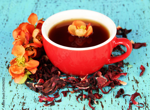 Plakat w ramie Herbal tea in cup, on color wooden background