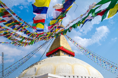 Staande foto Nepal Buddhist shrine Boudhanath Stupa with Buddha wisdom eyes and pra