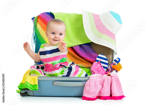 Deurstickers Regenboog Baby girl sitting in suitcase with things for vacation travel