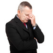 Portrait of a mature businessman looking depressed from work