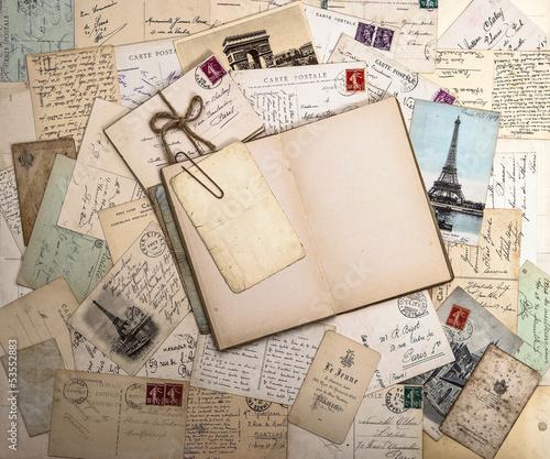 Obraz w ramie old postcards and open book. nostalgic vintage background
