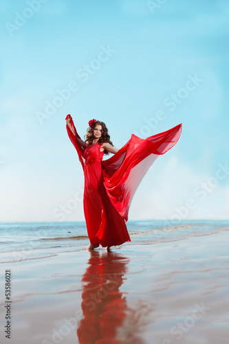 Deurstickers Akt Beautiful woman in a bright red dress