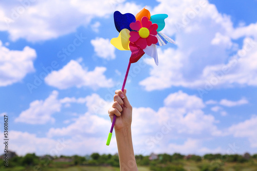 Valokuva Colorful pinwheel in hand, outdoors