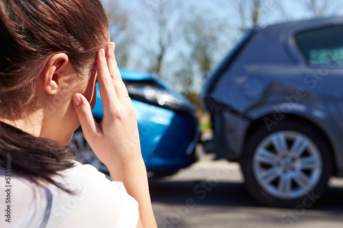 Stressed Driver Sitting At Roadside After Traffic Accident Canvas Print