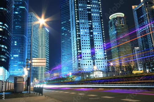 Fototapeta Modern office building background of car night with light trails obraz na płótnie