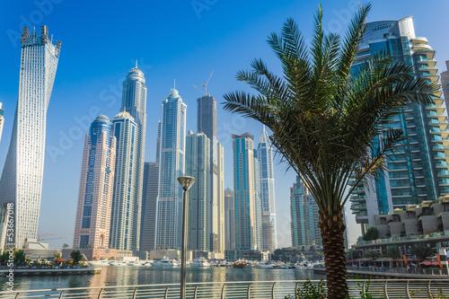 In de dag High rise buildings and streets in Dubai, UAE