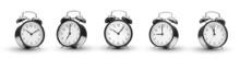 Row Of Alarm Clocks On White B...