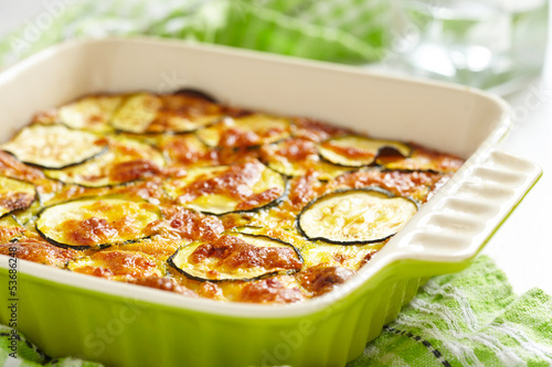 Foto op Plexiglas Klaar gerecht casserole with cheese and zucchini in baking dish