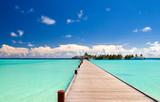 Fototapeta Bridge - Holzbrücke zum Strand einer einsamen Insel