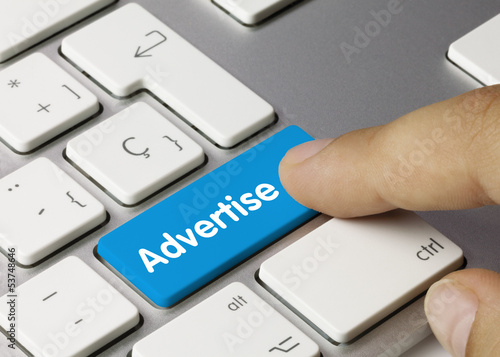 Fotografía  Advertise keyboard key finger