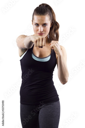 young woman in fighting stance on white background Poster