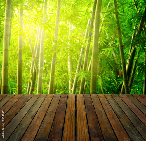 Foto op Plexiglas Bamboe bamboo forest with ray of lights and plank woods, suitable for p