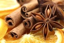 Close-up Of Dry Orange Slices, Cinnamon Sticks, And Anise Stars