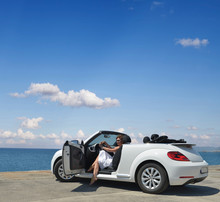 A Woman In A White Convertible