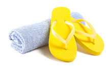 Yellow Flip Flop Shoes And Towel Isolated On White