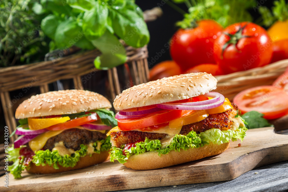 Fototapety, obrazy: Closeup of two homemade hamburgers made from fresh vegetables