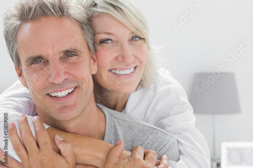 Photographie  Affectionate couple smiling at camera