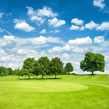 Green Golf Course And Blue Clo...