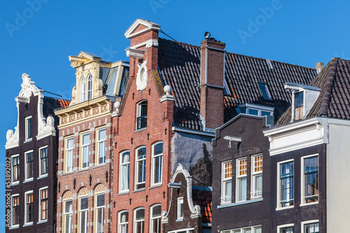 Photo  Ancient canal houses in the Dutch capital city Amsterdam