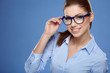 Leinwanddruck Bild - Cute young business woman with glasses