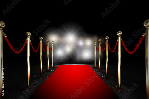 Fotografía  Rope barrier with red carpet and flash light