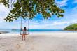 Beautiful woman feel lonely on beautiful beach
