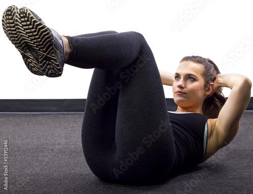Fotografie, Obraz  young Caucasian woman doing situps/crunches