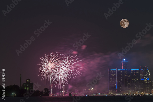 Foto op Plexiglas Volle maan Fireworks with full moon over detroit river