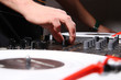 DJ adjusting soiund level on mixing controller