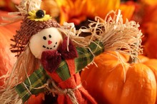Scarecrow On Colorful Autumn Background