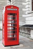 British red phone box on a London street - 53960627