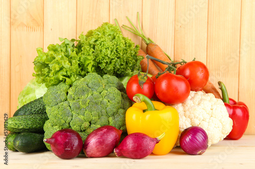 Fresh vegetables on wooden background © Africa Studio