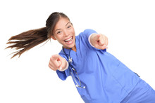 Excited Female Doctor Or Nuse Pointing At You