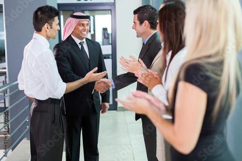 Fototapeta translator introducing arabian businessman obraz
