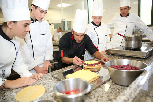 Fotografie, Obraz  Students with teacher in pastry training course